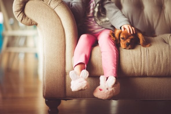 child sitting with bunny slippers